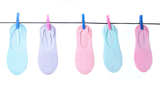 Women's  socks are hanging on clothespins clothesline isolated