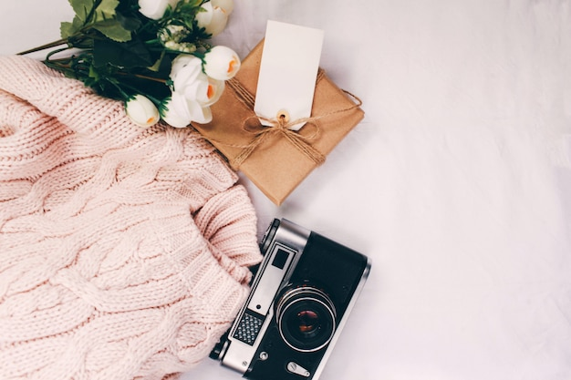 Women's spring outfit pink sweater and a gift for women's day