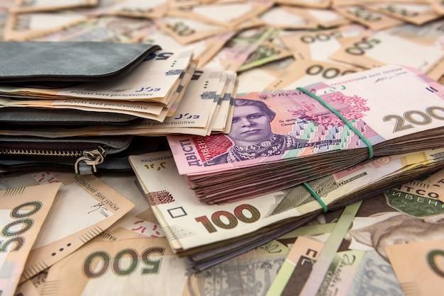 Women's wallet money in cash ukrainian hryvnia .