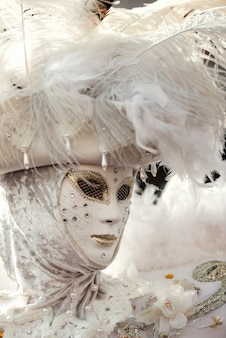 Women's white carnival mask with plumage