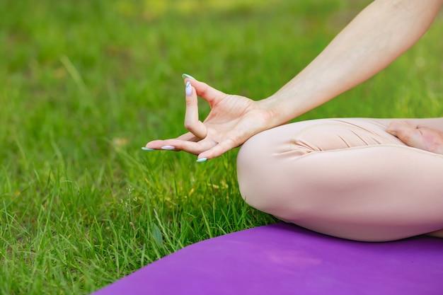 Women sitting in lotus pose, meditating or praying. healthy lifestyle