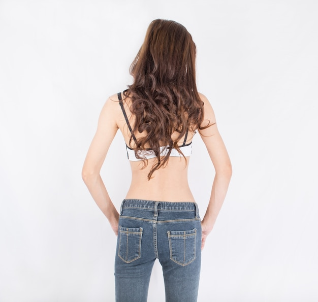 Women skinny back and jeans on white