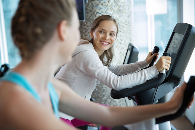 Women smiling on a cardio machine