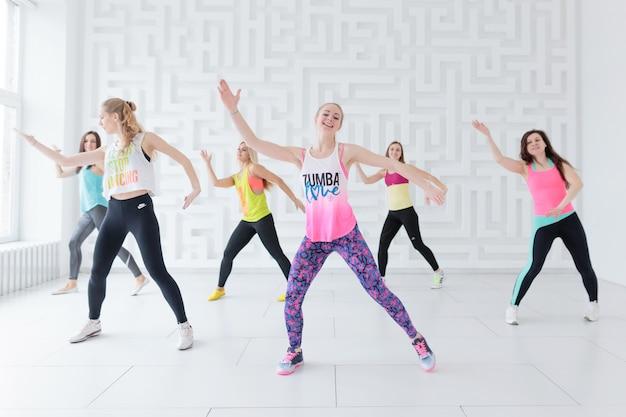 Women in sportswear at zumba dance class