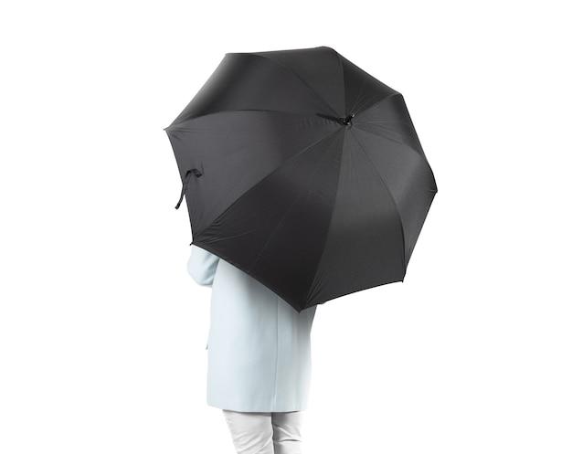 Women stand backwards with black blank umbrella opened  isolated.