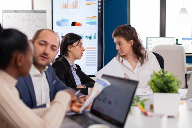 Women in startup office having a conversation in conference meeting room
