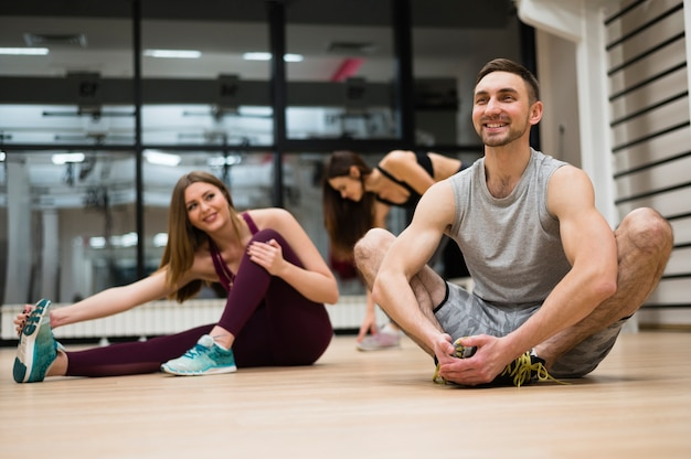Women stretching together with trainer