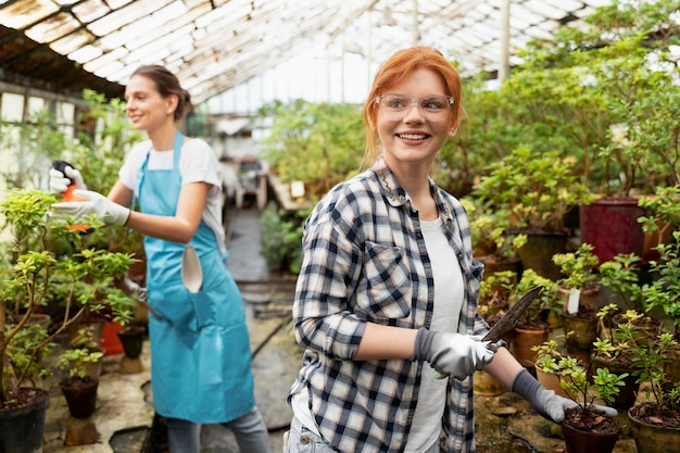 Women taking care of their plants in a greenhouse