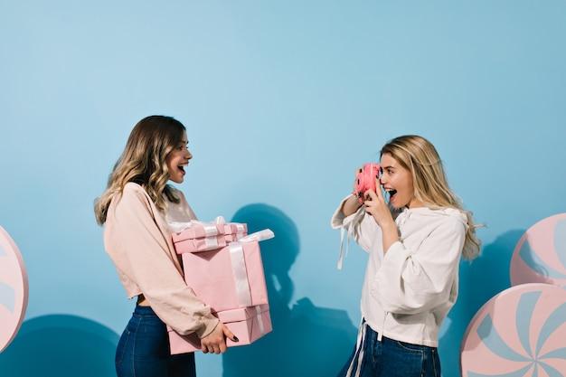 Women taking photos at party