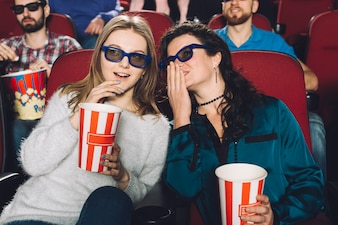 Women talking during movie