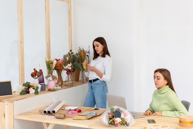 Women in their flower shop creating their investment plans
