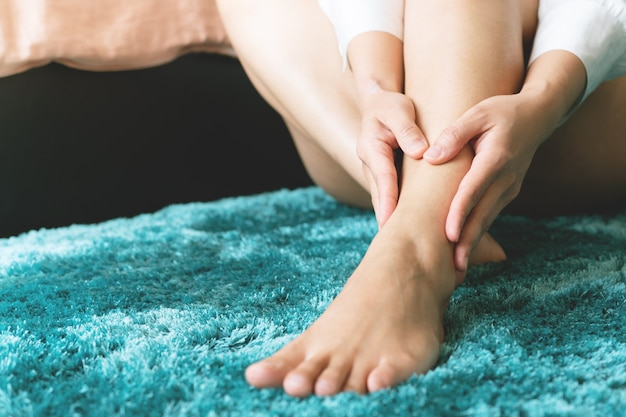 Women touch the leg ankle pain.