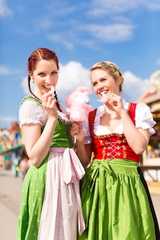 Women in traditional bavarian clothes or dirndl on festival