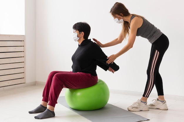 Women training together after coronavirus with face masks