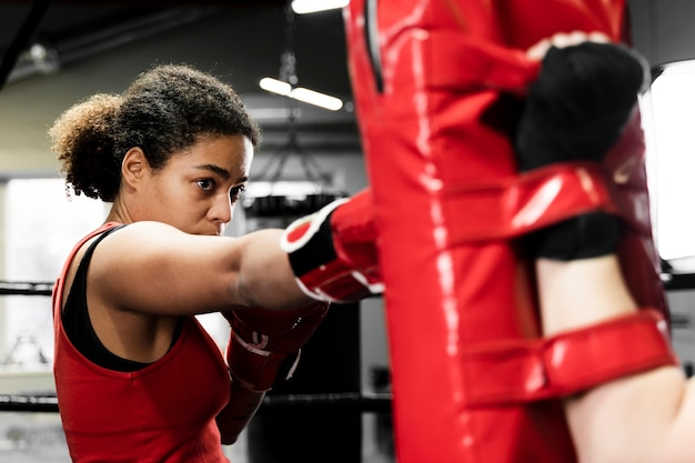 Women training together in boxing center