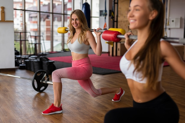 Women training together at gym