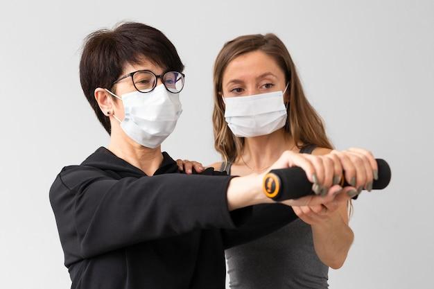 Women training while wearing medical masks