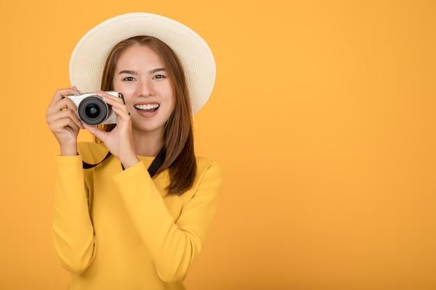 Women traveler holding film cameras and smiling.