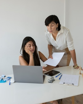Women trying to solve a project problem