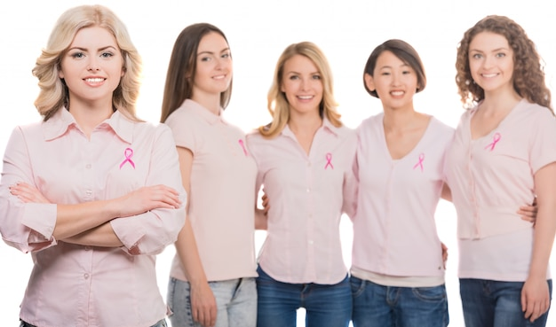 Women united with pink breast cancer awareness ribbon.