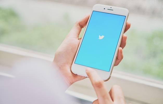 Women using phone open twitter application
