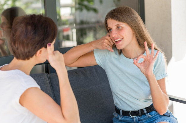 Women using sign language to converse with each other