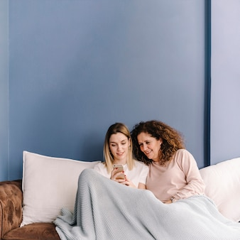 Women using smartphone together