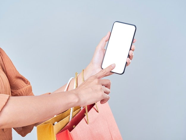 Women using smartphones to pay