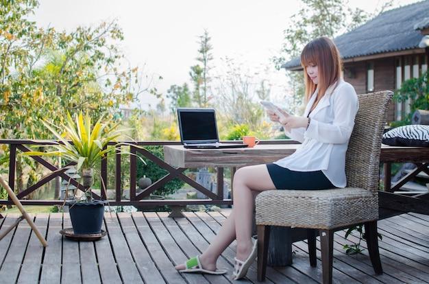 Women  using tablet outside in the garden