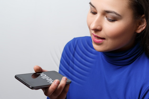 Women using the voice recognition function, smart phones