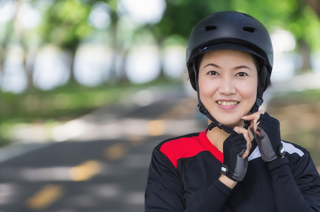 Women wearing bike helmet.