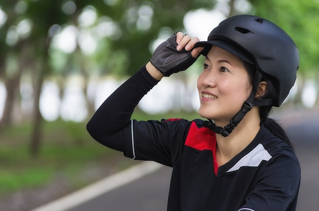 Women wearing bike helmet.