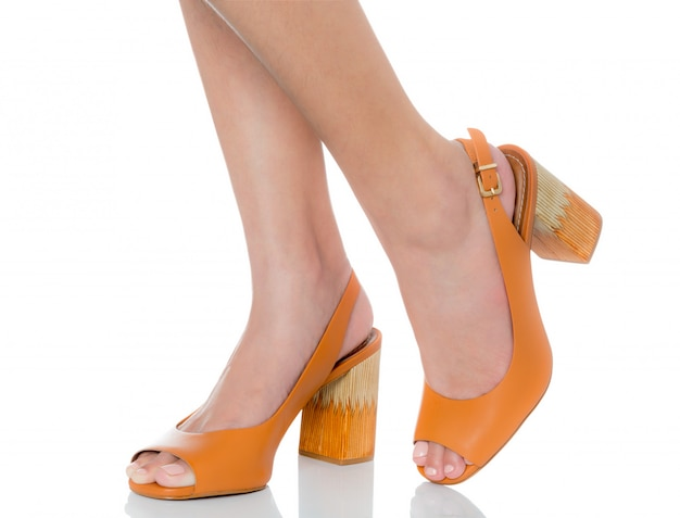 Women wearing leather chunky high heel fashion shoes with side view profile
