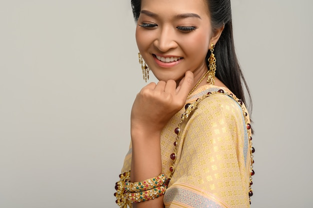 Women wearing thai clothes and hands touching their faces