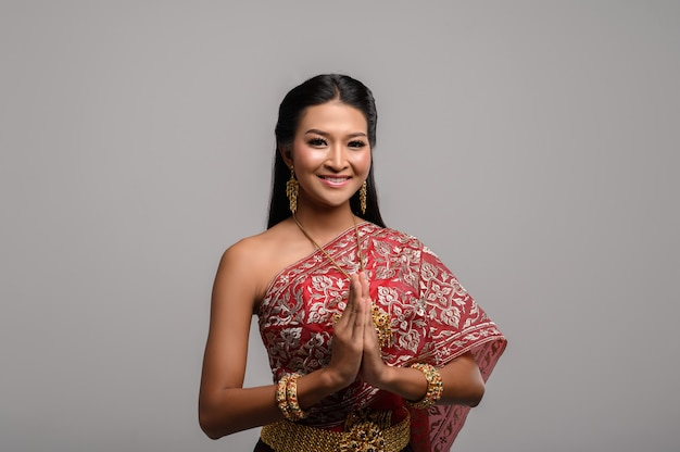 Women wearing thai clothing that pay respect,sawasdee symbol