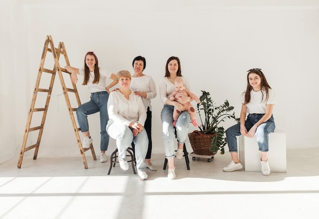 Women in white shirts and baby front view