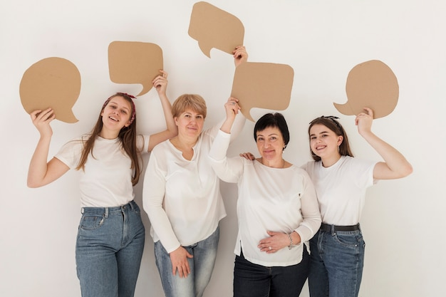 Women in white shirts holding chat bubbles