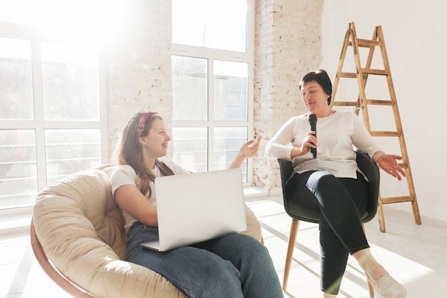 Women in white shirts using a laptop