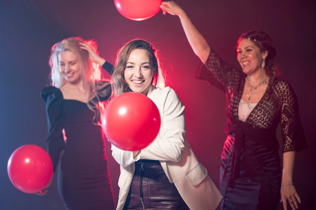 Women with balloons at party
