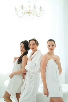 Women with bathrobe and towels