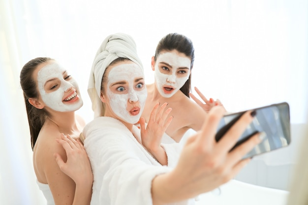Women with facial cosmetic products