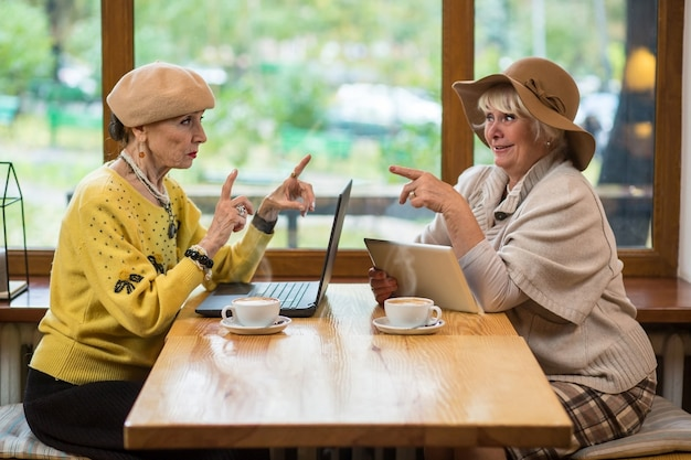 Women with gadgets at table