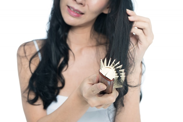 Women with hair problem holding hair in hand