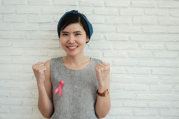 Women with pink ribbon, breast cancer awareness