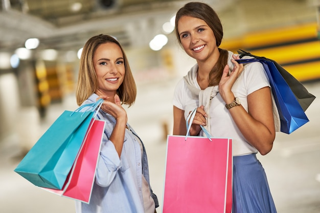 Women with shopping bags in underground parking lot
