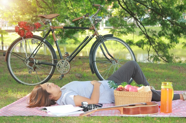 Women with sleeping in the park togetherness relaxation concept