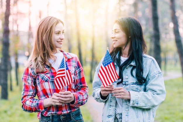 Women with small american flags standing outdoors