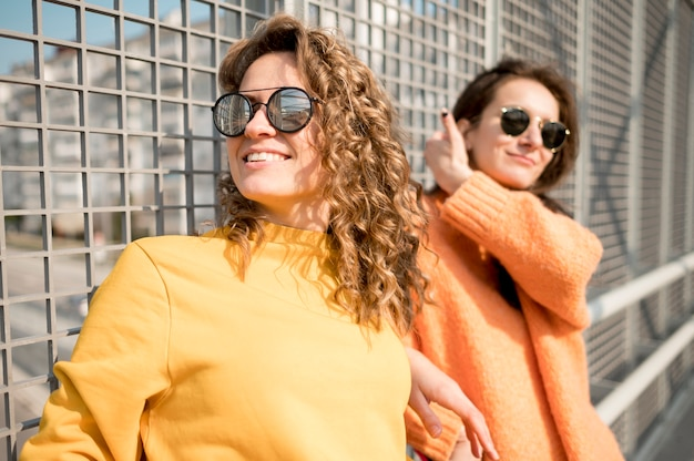 Women with sunglasses spending time together