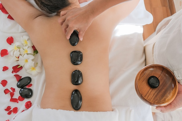 Women with therapeutic stones on her back