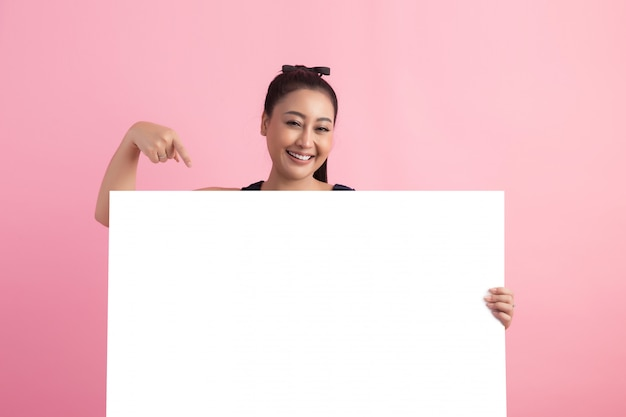 Women with white empty board, pointing away